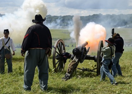 The 6th New York Independent Artillery fire a parrott rifle during a Civil War reenactment battle in Gettysburg, Saturday, July 6, 2013.